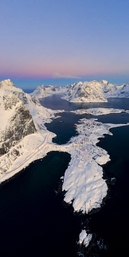 CLKRM112071 Aerial panoramic of Reine covered with snow at sunrise, Nordland, Lofoten Islands, Norway