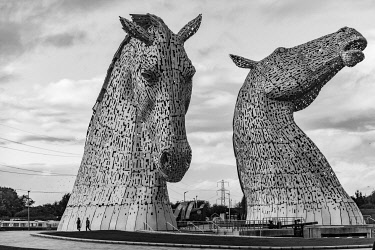 SCO35359 The Kelpies are the largest equine sculptures in the world. Located between Falkirk and Grangemouth in Scotland, The Kelpies� name reflects the mythological transforming beasts that possess the str...
