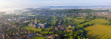 UK08570 Aerial view over Salisbury and Salisbury Cathedral on a misty summer morning, Salisbury, Wiltshire, England