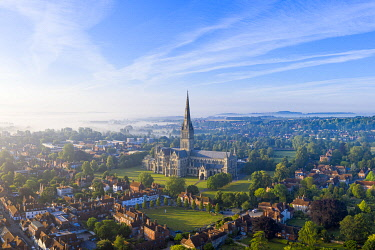 UK08571 Aerial view over Salisbury and Salisbury Cathedral on a misty summer morning, Salisbury, Wiltshire, England