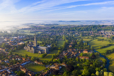 UK08573 Aerial view over Salisbury and Salisbury Cathedral on a misty summer morning, Salisbury, Wiltshire, England