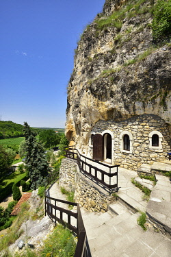 BUL332AW The rock-hewn Basarbovo Monastery (Monastery of Saint Dimitar Basarbowski) is a Bulgarian-orthodox cave monastery dating back to the 15th century. Bulgaria