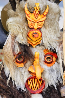 BUL384AW Bulgarian kukeri masks. They are used in winter solstice festivities by dancers that accompany musicians throughout the villages, dancing rhythmically to drive away evil and invite good. Veliko Tarnov...