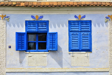 ROM1611AW Windows of traditional Saxon houses in Viscri, a Unesco World Heritage Site. Brasov county, Transylvania. Romania
