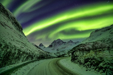 NOR1078AW Aurora Borealis over Mountain Road in Winter, Senja, Norway