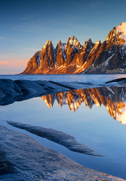 NOR1084AW The Devil's Jaw Reflecting in Tide-pool, Senja, Norway