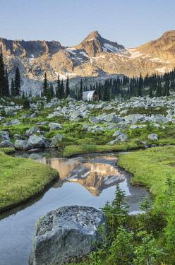 CN02AMA0001 Mountains reflected in creek, subalpine meadows of Marriott Basin, Coast Mountains, British Columbia