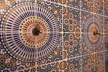 AF29BJY0019 Africa, Morocco. Close-up of tile design patterns around faucets