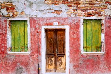 EU16BJY0368 Europe, Italy, Veneto, Burano. Weathered house exterior
