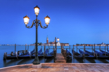 EU16BJY0415 Europe, Italy, Venice. Sunset on gondolas and San Giorgio Maggiore church