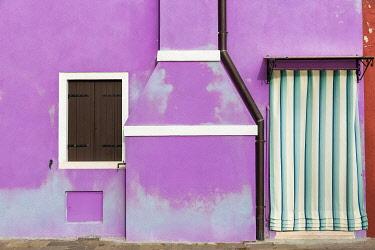 EU16BJY0433 Italy, Burano. Weathered house exterior