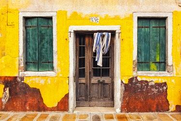EU16BJY0440 Italy, Burano. Weathered house exterior