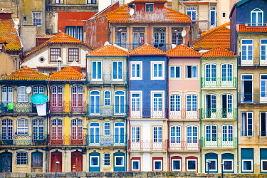 EU23BJY0039 Europe, Portugal, Porto. Colorful building facades next to Douro River
