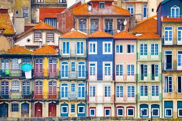 EU23BJY0039 Europe, Portugal, Porto. Colorful building facades next to Douro River