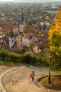 EU38BTH0013 Slovenia, Ljubljana. Late afternoon light falling on the heart of the old town, and a woman as she walking down the hill. (Editorial Use Only)