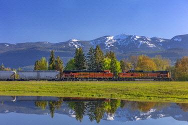 US27CHA4119 Burlington Northern freight train coming into Whitefish, Montana, USA