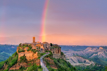 Rainbow over Civita di Bagnoregio at sunset, Bagnoregio, Lazio, Italy, Europe.