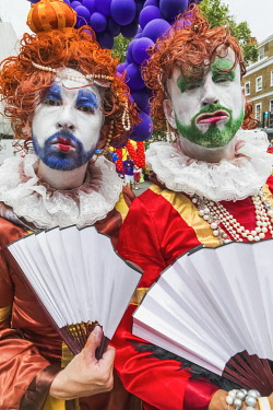 TPX71365 England, London, The Annual Pride Festival, Two Bearded Men Dressed in Colourful Womens Dresses