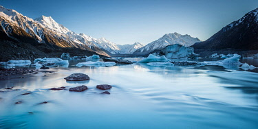 NZ9357AW Icebergs in Tasman Lake  with the Minarets in background.  Mount Cook, Otago, South Island, New Zealand