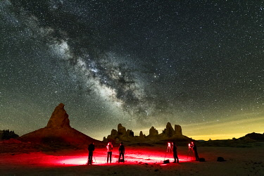 USA14646AW Photographers Capturing Milky Way over Trona Pinnacles, Trona, California, USA