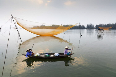 VIT1735AWRF Fishermen row around fishing nets at sunrise, Thu Bon River, Quang Nam Province, Vietnam