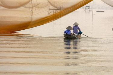 VIT1750AW Fishermen row around fishing nets at sunrise, Thu Bon River, Quang Nam Province, Vietnam