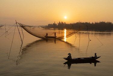 VIT1760AW Fishermen row around fishing nets at sunrise, Thu Bon River, Quang Nam Province, Vietnam