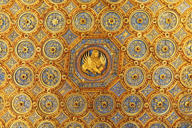 ITA14794AW Gold ceiling featuring winged lion holding bible in the historical library of the school of St. Mark, Campo San Giovanni e Paolo, Venice Carnival , Venice Veneto, Italy