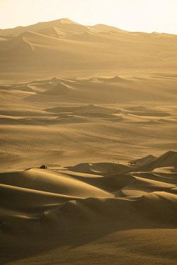 PER34380AWRF People with dune buggy tour of desert near Huacachina during sunset, Ica Region, Peru
