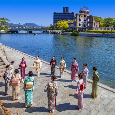 JAP2048 Japanese women in national costumes at the Peace Memorial Park with the Hiroshima Atomic Bomb Dome Building in the background, Kamiyacho, Hiroshima Ken, Japan.