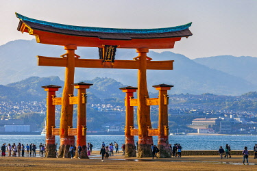 JAP2051 Tourists wander around the Itsukushima Floating Torii Gate at low tide, Miyajima, Fukae, Hiroshima Ken, Japan.