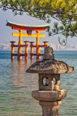 JAP2056 Street lamp detail and the Itsukushima Floating Torii Gate at high tide in the background, Miyajima, Fukae, Hiroshima Ken, Japan.