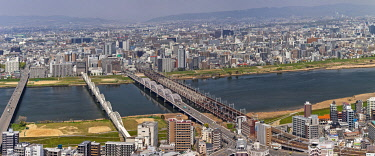 JAP2069 Panoramic view of  the bridges crossing the Yodo River, North Osaka, Oyodokita, Oyodominami, Osaka Fu, Japan.