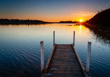 AUS3612AW Sunstar and jetty at Lake Corringle.  Corringle, Gippsland, Victoria, Australia