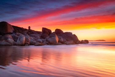 AUS3619AW Rocky headland of Whisky Bay with fiery sunset. Wilsons Promontory National Park, Gippsland, Victoria, Australia