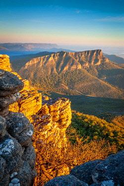 AUS3640AW Strong sunlight lights Redmans Bluff. Redmans Bluff, Grampians National Park, Victoria, Australia