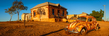 AUS3644AW Volkswagen Beetle sits outside an outback artists studio.Silverton, Far West, New South Wales, Australia