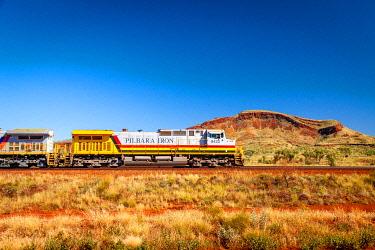 AUS3726AW Pilbara Iron diesel locomotive carrying iron ore through outback. Pilbara Outback, Pilbara, Western Australia, Australia
