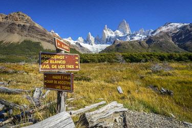 ARG3116AW Trail direction signs against iconic Fitz Roy mountain, Sendero al Fitz Roy, UNESCO, Los Glaciares National Park, El Chalten, Santa Cruz Province, Argentina