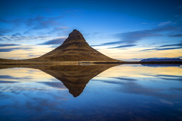 ICE4159AW Kirkjufell mountain reflecting in still water against blue sky during sunset, Snaefellsness Peninsula, Western Iceland, Iceland