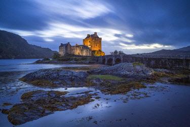 SCO35522AW Illuminated Eilean Donan Castle at dusk, The Highlands, Scotland, United Kingdom