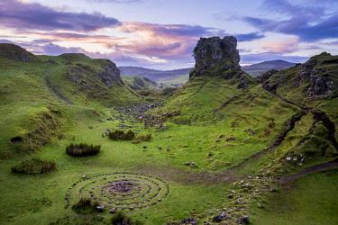 SCO35529AW Circular rock pattern on green landscape near Castle Ewen at sunset, Fairy Glen, Isle of Skye, Highland Region, Scotland, United Kingdom