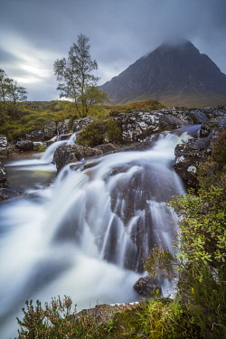 SCO35532AW Stream flowing through rocks against Buchaille Etive Mor mountain in Glen Coe, Highland Region, Scotland, United Kingdom