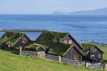 HMS3338572 Denmark, Faroe Islands, Streymoy Island, Kirkjubour, turf roof houses