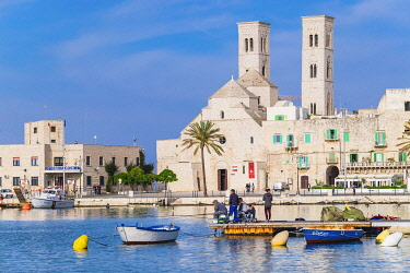 HMS3324292 Italy, Apulia, Molfetta, the fishing harbour on the Adriatic Sea and Saint-Conrad Old Cathedral or Duomo di San Corrado built in the twelfth&#x2013,thirteenth centuries