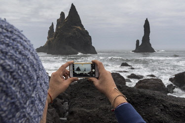 HMS3357239 Iceland, South Iceland, Sudurland Region, Vik, Reynisfjara beach and Reynisdrangar needles, iphone