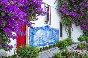 HMS3358613 Portugal, Lisbon, Alfama district, Miradouro de Santa Luzia, historical panels in azulejos on the wall of Santa Luzia church