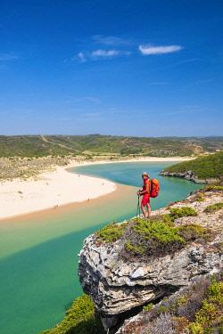 HMS3373869 Portugal, Algarve region, Southwest Alentejano and Costa Vicentina Natural Park, Aljezur, Praia da Amoreira at the mouth of Aljezur river