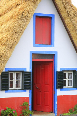 HMS3453481 Portugal, Madeira Island, Santana, UNESCO Biosphere Reserve, typical thatched roof house
