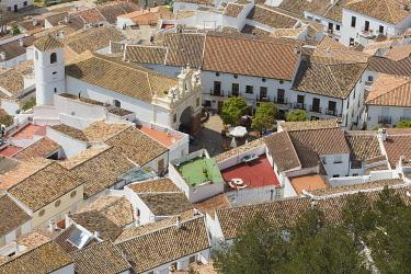 HMS3287204 Spain, Andalucia, Cadiz Province, Zahara de la Sierra, Sierra de Grazalema natural parc, Ruta de los Pueblos Blancos (white villages road), hign angle view of the tiled roofs and San Juan de Letran ch...